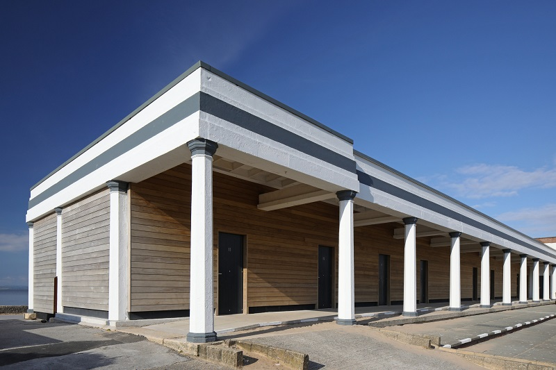 Beach huts share timber with tower